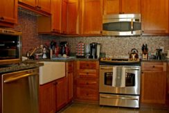 jackson-gore-real-estate-okemo-mountain-resort-adams-house-gallery-501-504-kitchen-1030x830
