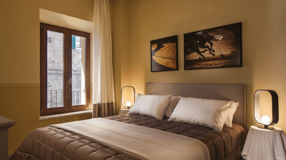 bedroom of remodeled siena italy building